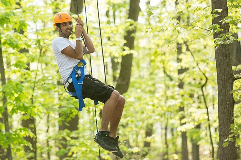 A student using the Keuka College ropes course