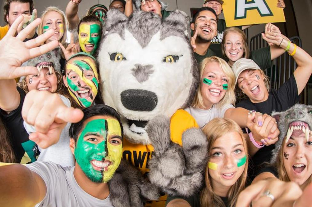 Students in a group with Kacey the Wolf