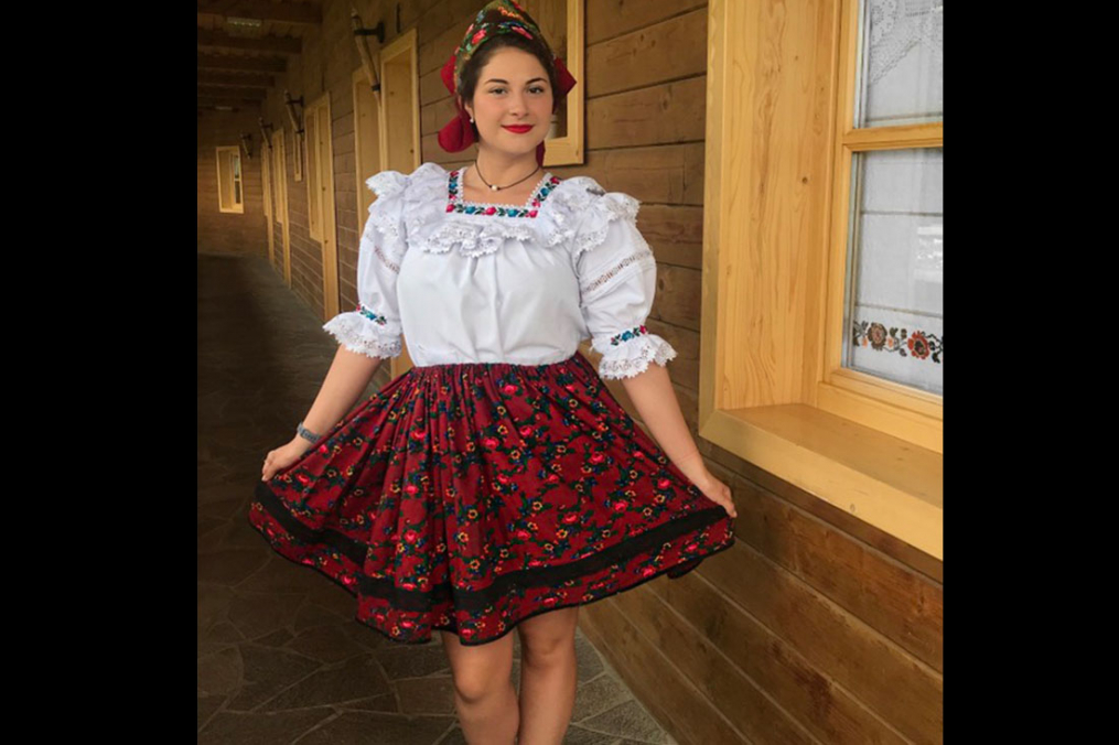 Ashley DeFreitas poses for a photo while on her Field Period dressed in traditional Romanian dressy clothing