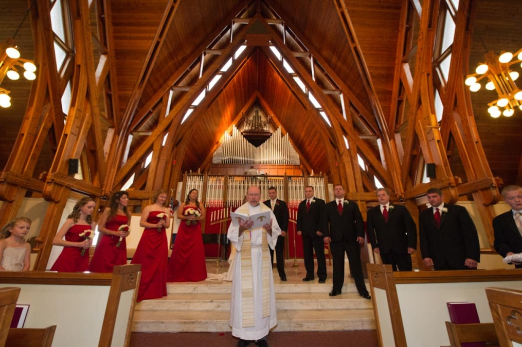 photo of bridesmaids and groomsmen standing inside the chapel