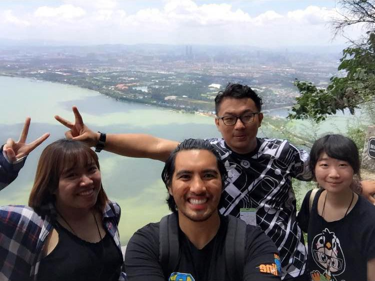 A Keuka College student takes a selfie with three students at Yunan University.